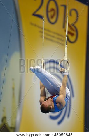 MOSCOW, RUSSIA - APRIL 20: Danny Pinheiro-Rodrigues, France performs exercise on still rings in final of 5th European Championships in Artistic Gymnastics in Moscow, Russia on April 20, 2013