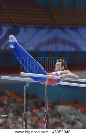 MOSCOW, RUSSIA - APRIL 21: David Belyavskiy, Russia performs exercise on parallel bars in final of 5th European Championships in Artistic Gymnastics in Moscow, Russia on April 21, 2013