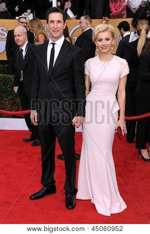 LOS ANGELES - JAN 27:  Noah Wyle and Sarah Wells arrives to the SAG Awards 2013  on January 27, 2013 in Los Angeles, CA