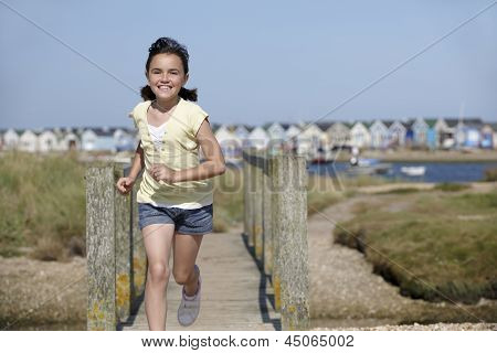 Young Girl Running Towards Camera