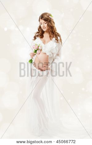 Pregnant Woman. Beautiful Pregnancy: Long Curly Hair And Chiffon Dress Fluttering On Wind.