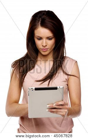 Brunette Woman Using A Computer Tablet