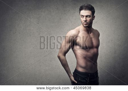 muscular man on gray background