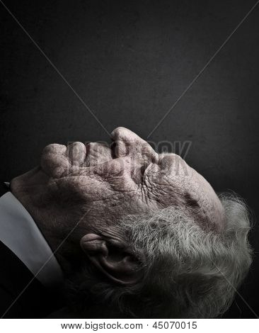 close-up old man lying down with eyes closed