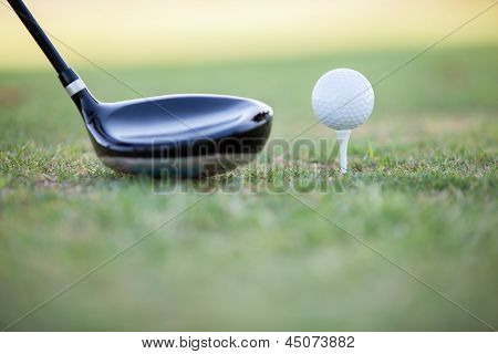 Golf club and ball ready for tee off