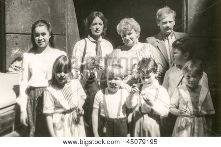 Vintage photo of big family with children, eighties