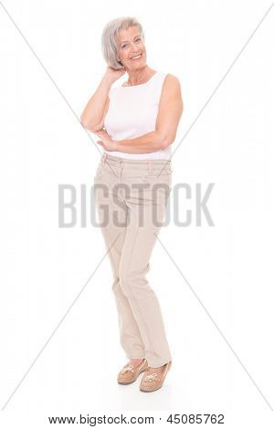 Standing senior woman in front of white background