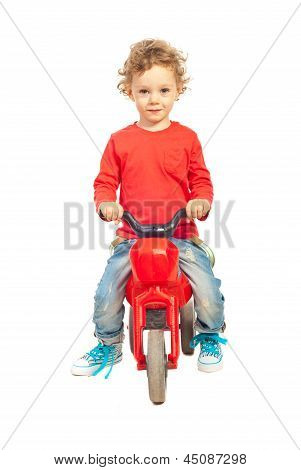 Smiling Boy With Plastic Bike