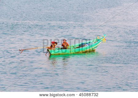 Fisher Man And Green Boat