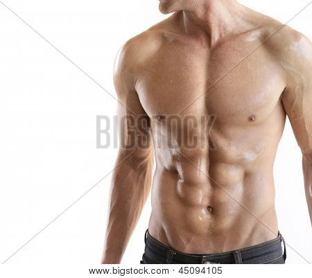 Torso of strong guy in jeans against white