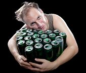 stock photo of bing  - The drunk man and is a lot of empty beer cans - JPG