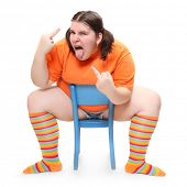 stock photo of pubescent  - Crazy teenager on a blue chair - JPG