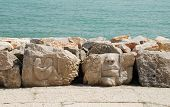 stock photo of rock carving  - Carved rocks along the promenade at Caorle in Veneto Italy - JPG