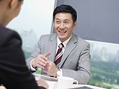 pic of negotiating  - asian business people discussing business in office - JPG