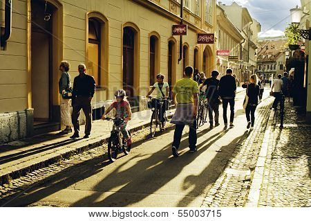 Ljubljana, Slovenia - September 4: Tourists And Local Kids On Bicycles On The Crowded Street Of City