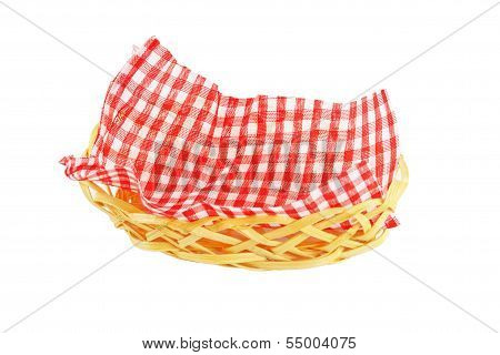 Wicker Basket With A Checkered Napkin