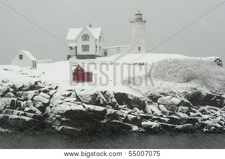 Maine's Nubble Lighthouse In Snowstorm.