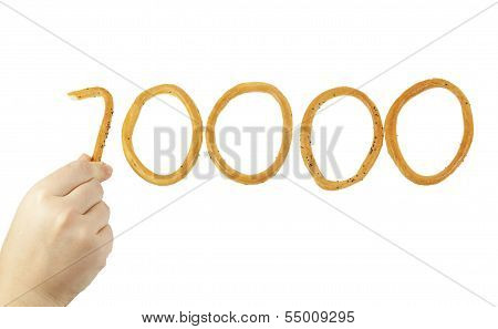Hand Puts The Number Of Ten Thousand Of Bagels