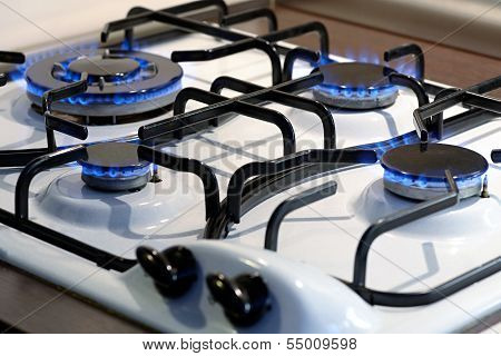Four Burning Gas Plates On A Stove