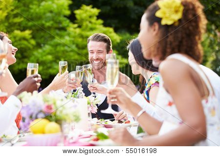Group Of Friends Enjoying Outdoor Dinner Party