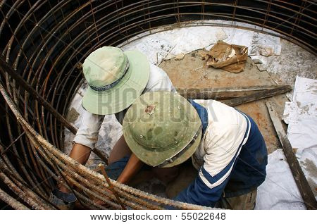 Workers Casting Cement Culvert For Road-works