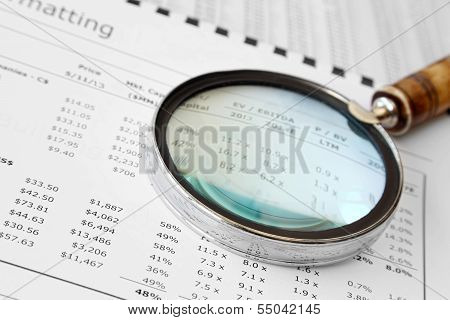 Magnifying Glass Over Financial Document