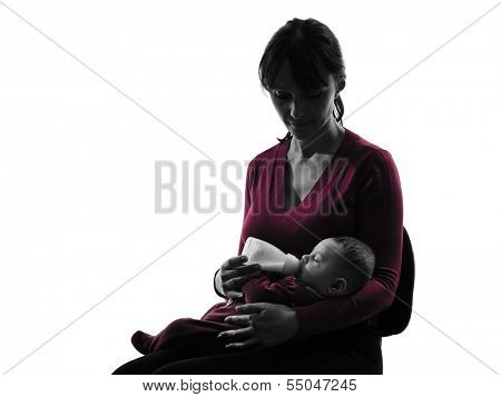 one caucasian woman feeding bottle baby   silhouette on white background