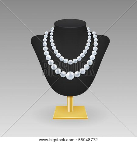 Pearl necklace on a rack