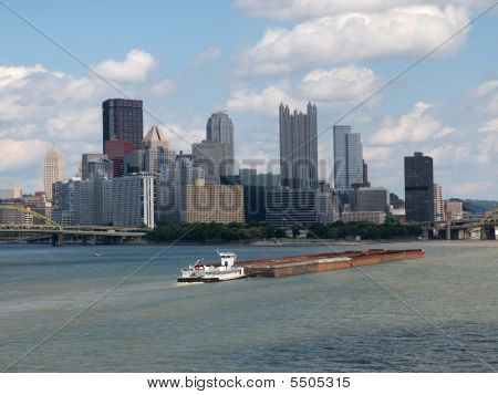 Pittsburgh Waterfront With Barge