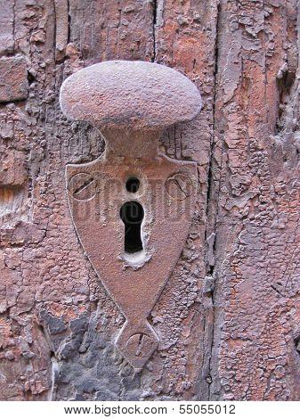 Keyhole, weathered.