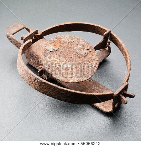 Rusty Trap Isolated On Grey Background