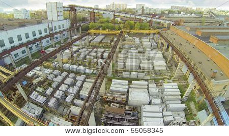 Top view of warehouse with construction materials near factory. View from unmanned quadrocopter.