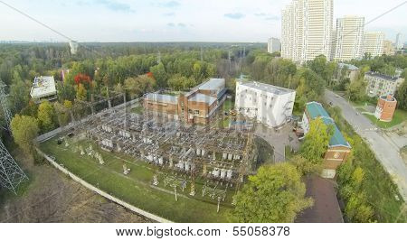 Power station near residential complex at day. View from unmanned quadrocopter.