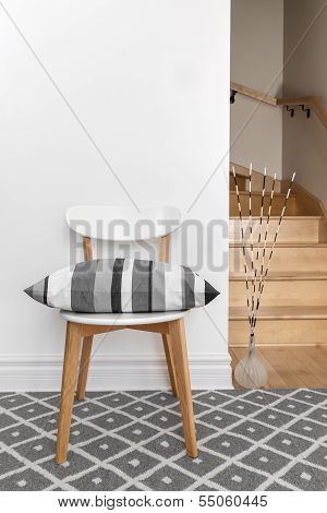 Chair With Cushion In A Room With Staircase