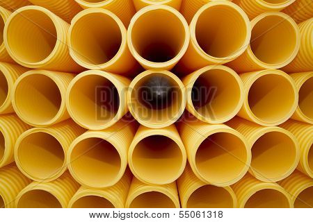 Yellow plastic pipes full frame