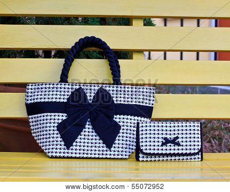 Luxury women bag on table in garden