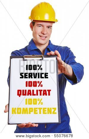Construction worker with clipboard making advertising with German words for 100% service 100% quality and 100% competence