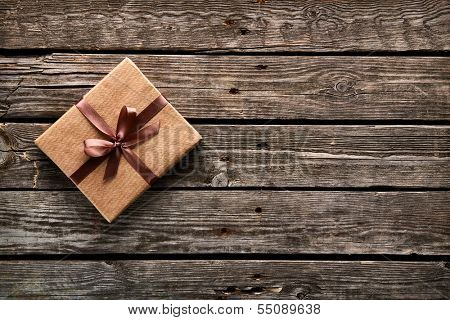 Vintage gift box on old wooden background.