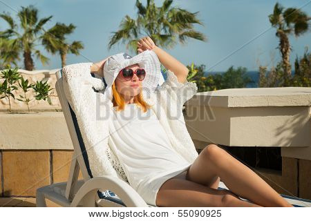 Young woman enjoying sun