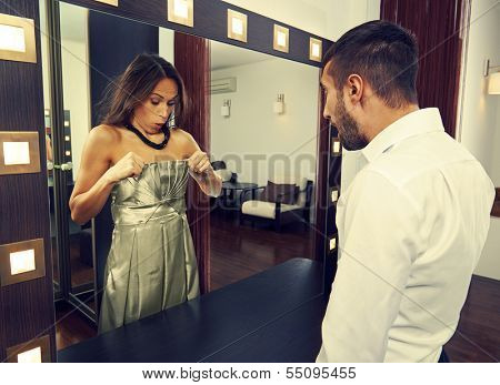 amazed man looking at woman in the mirror