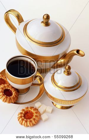 gold and white tea service