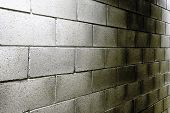 image of oblique  - Background texture of obliquely angled cement blocks in a commercial building wall - JPG