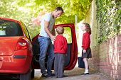 foto of driving school  - Father Driving To School With Children - JPG
