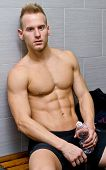 Shirtless Handsome Male Athlete Resting On Bench, Water Bottle In Hand