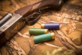foto of shotgun  - A wooden retro shotgun with shotgun shells - JPG