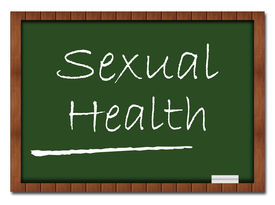 pic of std  - Sexual Health text written on a green board with chalk - JPG