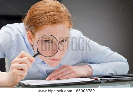 Strict Businesswoman Analyzing Documents