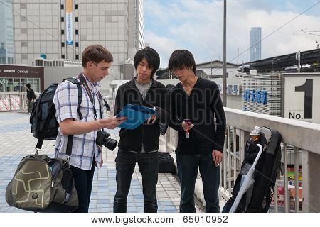 OSAKA, JAPAN - MAY 28, 2008: Tourist clarifies details of the route from the locals. Osaka - the third largest city in Japan, every year hundreds of thousands tourists and businessmen attend city.
