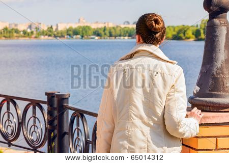 Woman Looking At The River