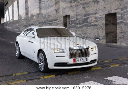 ABU DHABI, UAE - MARCH 29: Rolls-Royce Wraith at the Etihad Towers Hotel in Abu Dhabi on march 29 2014. In Abu Dhabi is one of the richest cities in the world with many luxury cars on the street.